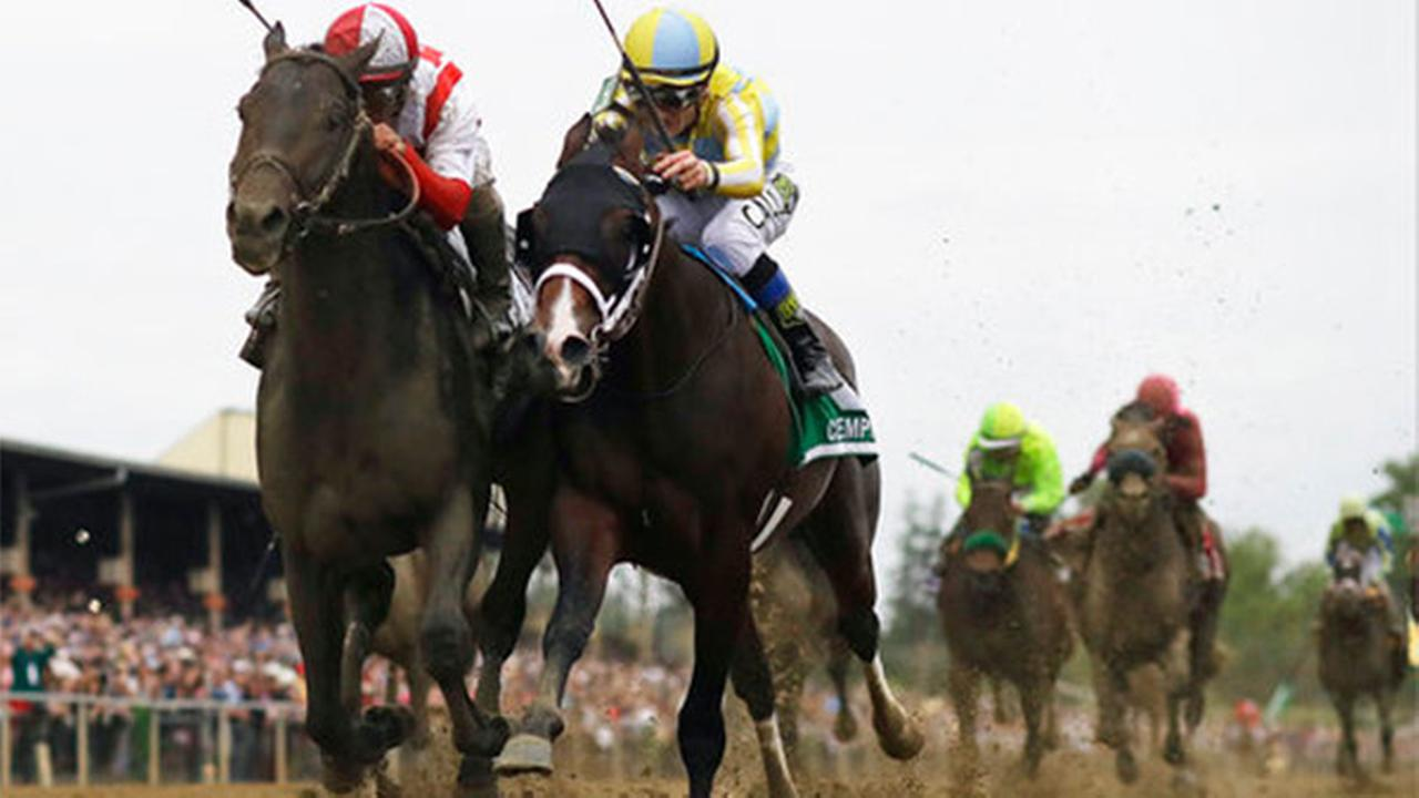 Cloud Computing, left, ridden by Javier Castellano, wins the 142nd Preakness Stakes horse race ahead of Classic Empire, ridden by Julien Leparoux, Saturday, May 20, 2017.
