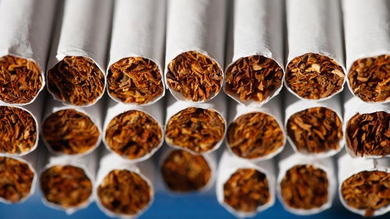 Displayed for a photograph is cigarette tobacco, Tuesday, July 15, 2014, in Philadelphia. (AP Photo/Matt Rourke)