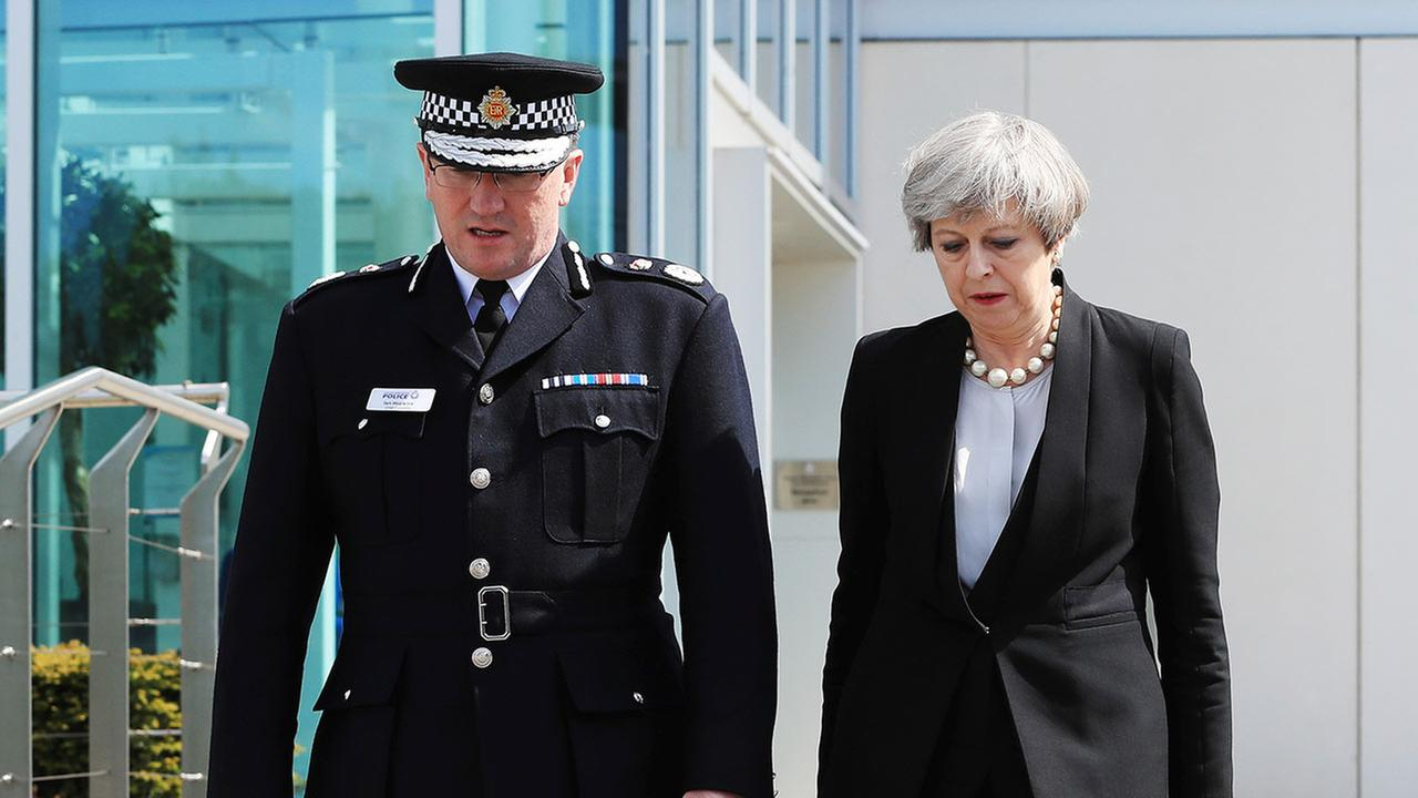 Britains Prime Minister Theresa May walks with Greater Manchester Police chief constable, Ian Hopkins,  in Manchester, England, Tuesday May 23, 2017  (Peter Byrne/PA via AP)