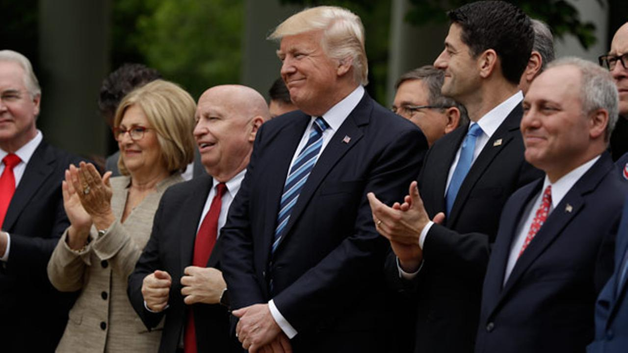 President Donald Trump, flanked by House Ways and Means Committee Chairman Rep. Kevin Brady, R-Texas, and House Speaker Paul Ryan of Wis., are seen in the Rose Garden.