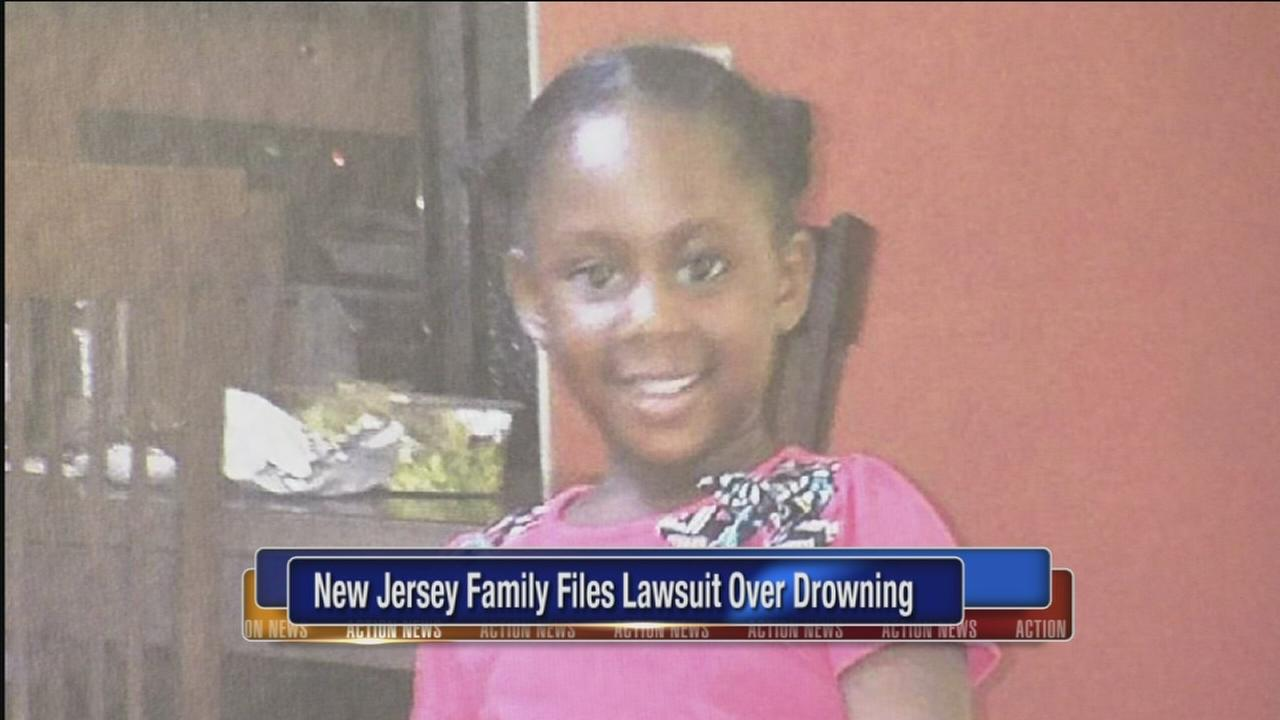 Family files lawsuit over girls drowning