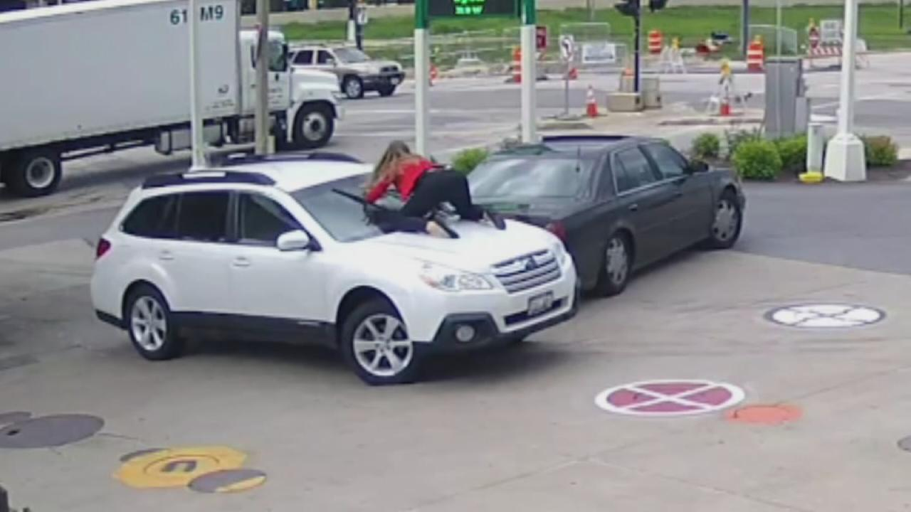 Woman jumps on hood of her SUV to prevent theft