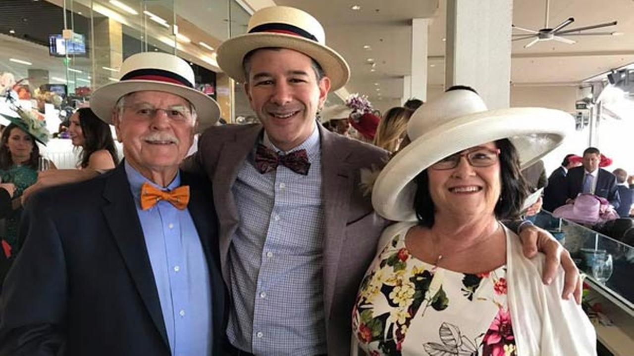 In this May 6, 2017 photo provided by Travis Kalanick, Uber CEO, Kalanick, center, poses with his mother, Bonnie, right, and father, Donald Kalanick, left, at the Kentucky Derby.