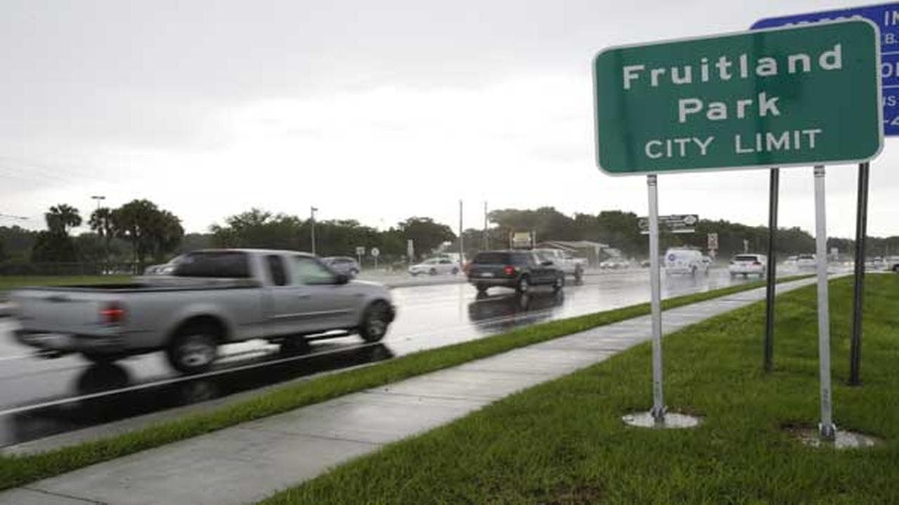 In this July 16, 2014 photo, cars pass by on a six lane highway that runs through Fruitland Park, Fla.