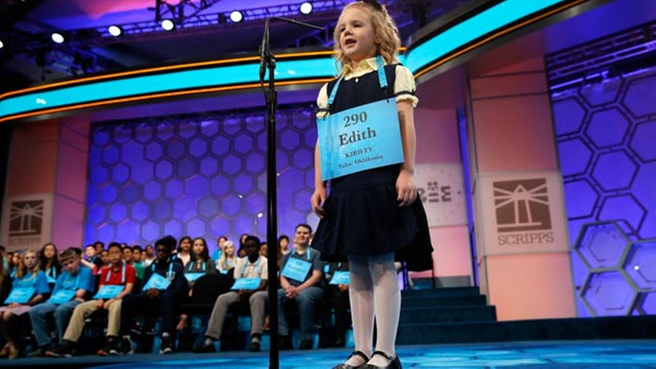 Edith Fuller, 6, of Tulsa, Okla., the the youngest speller in history in the National Bee, smiles as she spells her word correctly during the 90th Scripps National Spelling Bee.