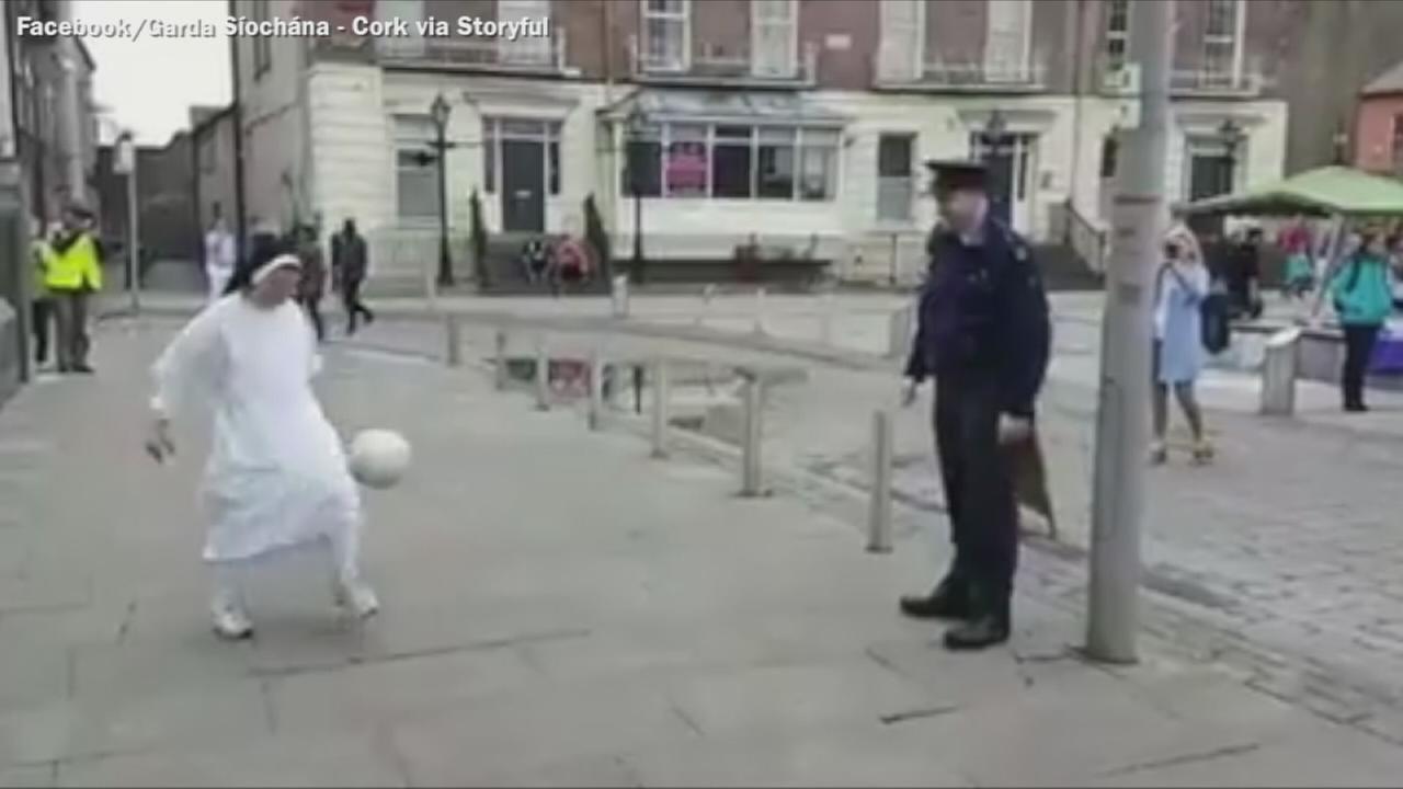 VIDEO: Policeman plays game of soccer with Irish nun