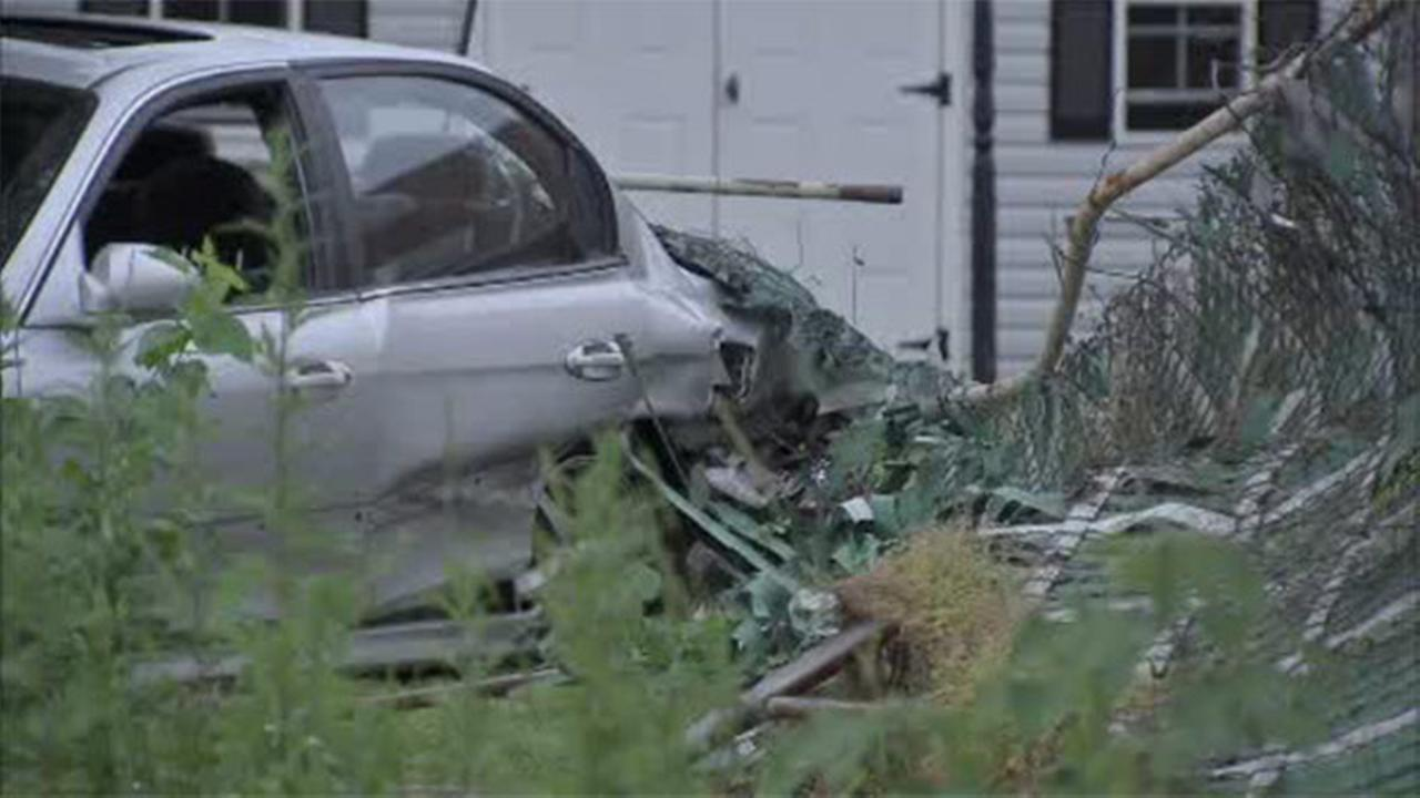Police: Driver loses control, crashes in SW Philadelphia yard