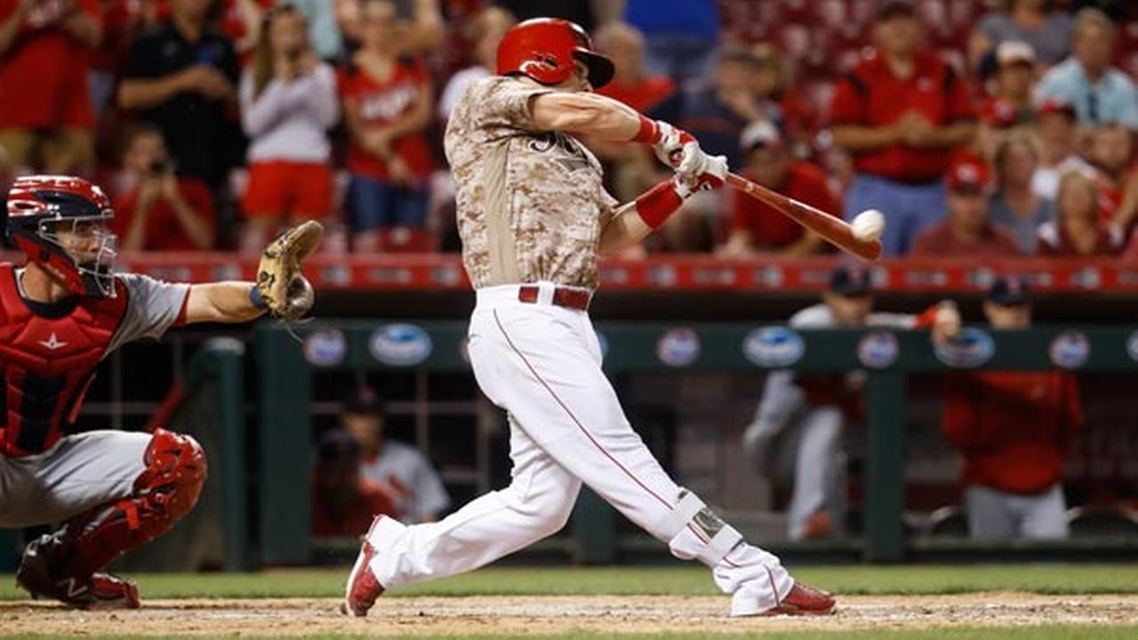 Cincinnati Reds Scooter Gennett hits a two-run home run and his fourth overall in the eighth inning of a baseball game against the St. Louis Cardinals, Tuesday, June 6, 2017.