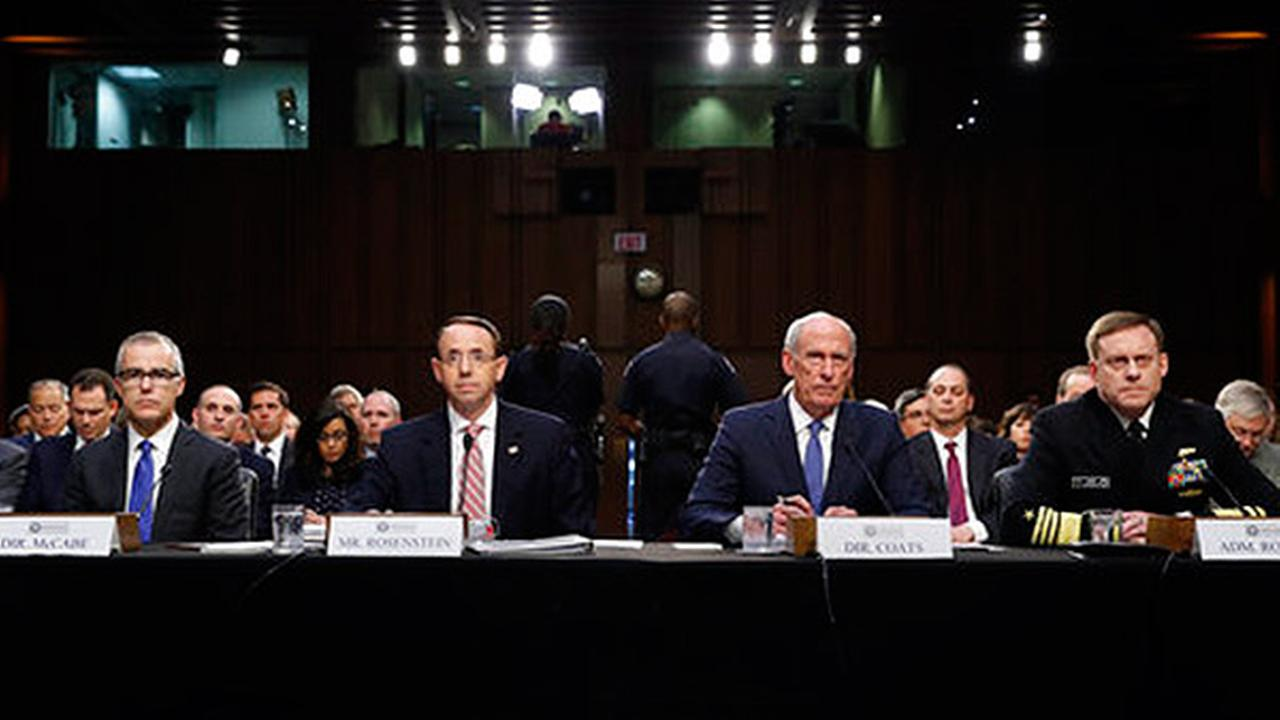 From left, Acting FBI Director, Deputy Attorney General, National Intelligence Director and National Security Agency Director during a Senate Intelligence Committee hearing.