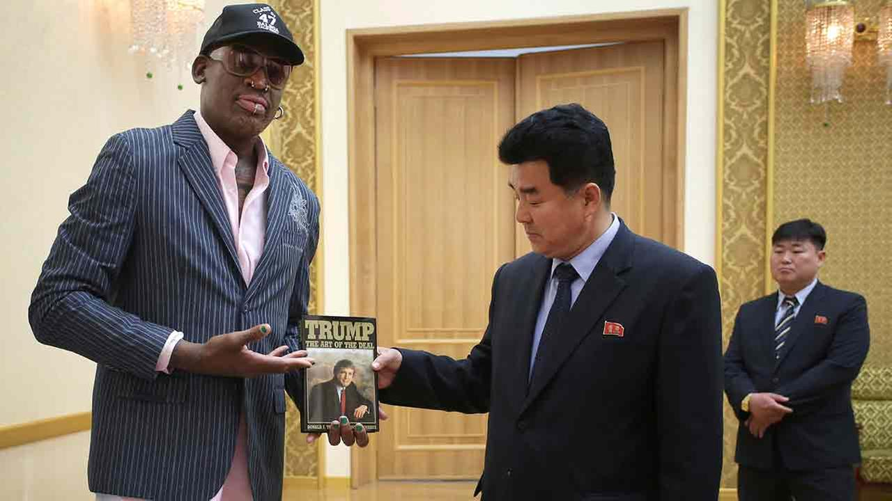 Former NBA basketball star Dennis Rodman presents a book titled Trump The Art of the Deal to North Koreas Sports Minister Kim Il Guk Thursday, June 15, 2017.