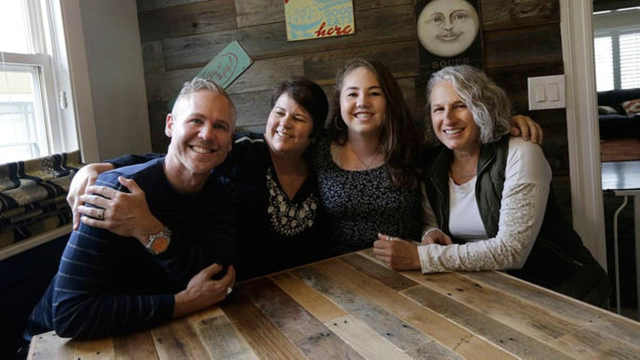 In this June 8, 2017 photo, Madison Bonner-Bianchi, second from right, poses for photos with her parents Mark Shumway, from left, Kimberli Bonner and Victoria Bianchi in Oakland.