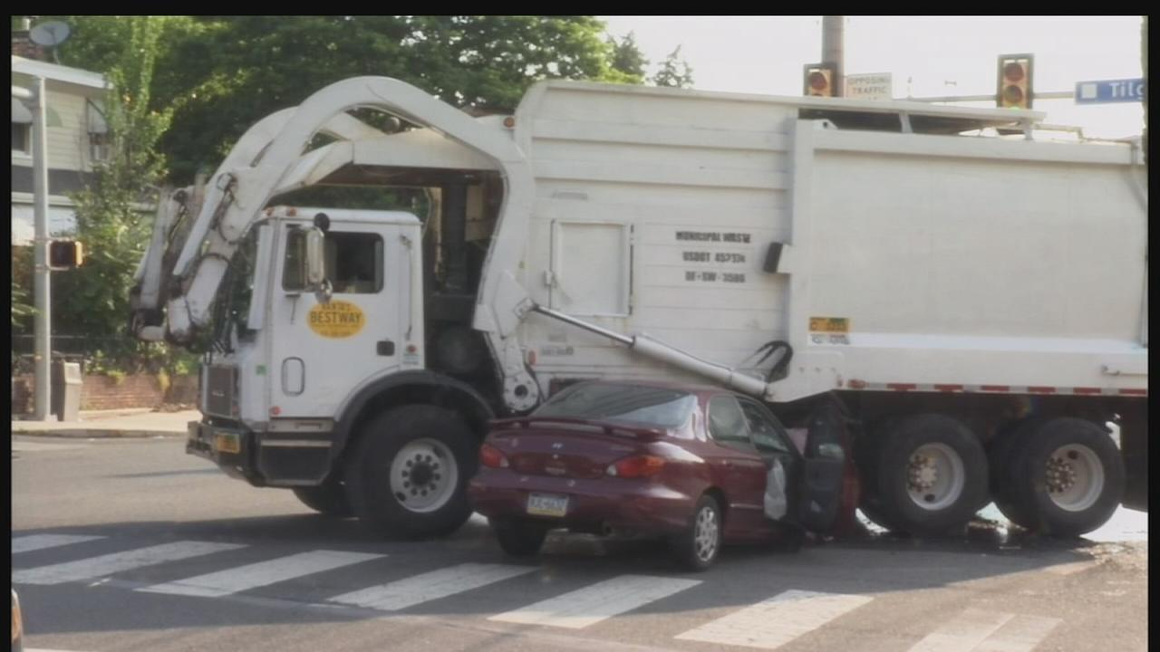 1 hurt in trash truck crash