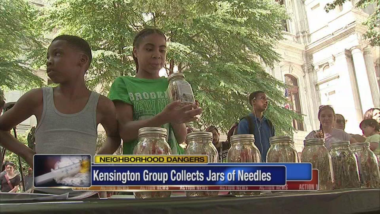 Kensington group delivers needle jars to City Hall