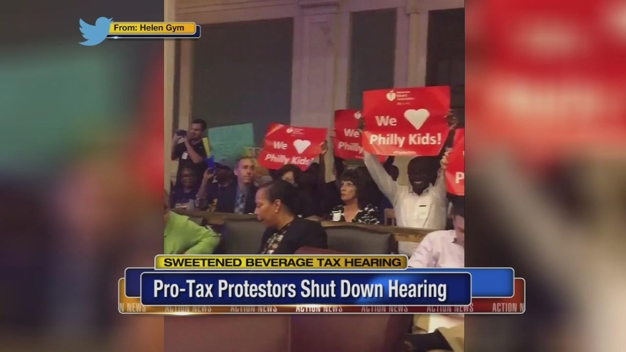 Beverage tax hearing drowned out by protests
