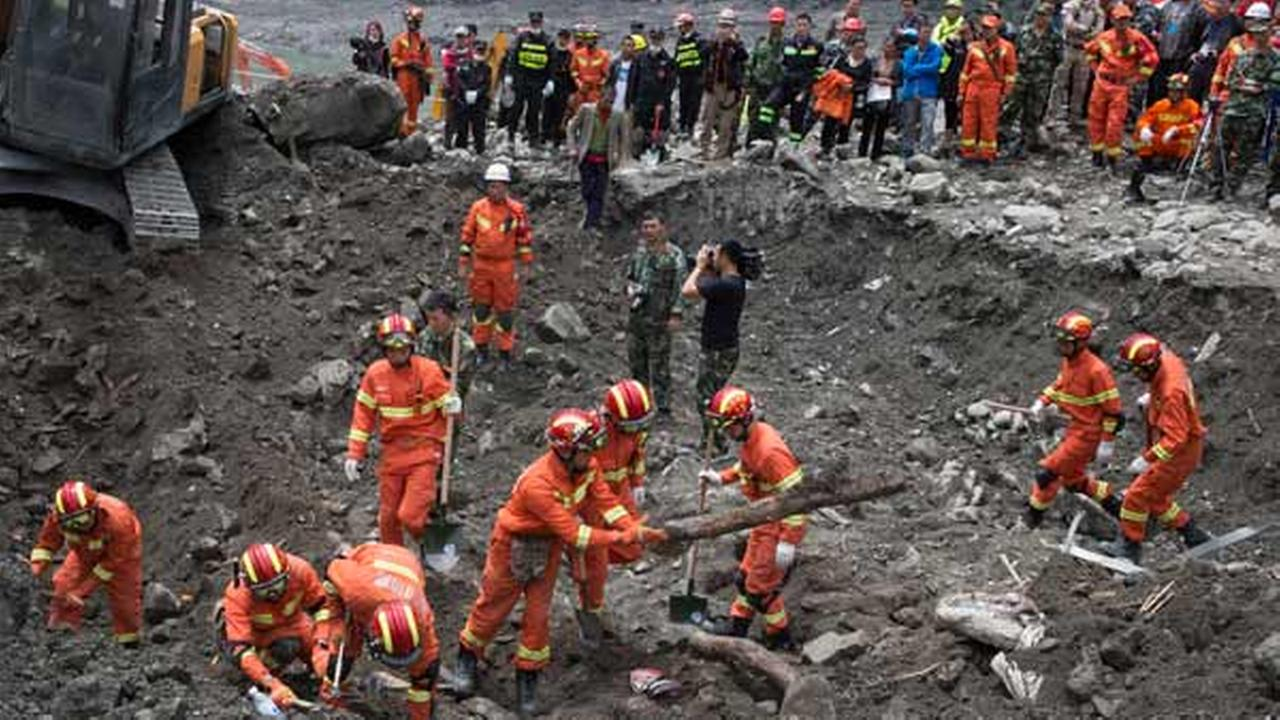 Rescue workers search for victims of a landslide in Xinmo village in Maoxian County in southwestern Chinas Sichuan Province, Sunday, June 25, 2017.