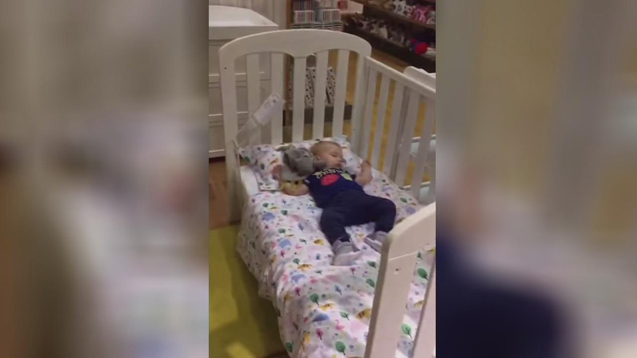 Dad lets nap in department store display bed