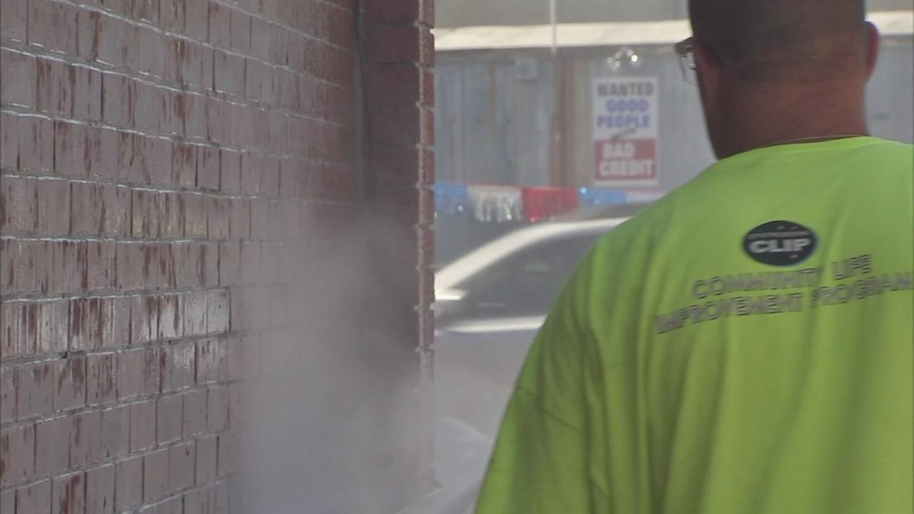Crews remove spray-paint in South Philadelphia