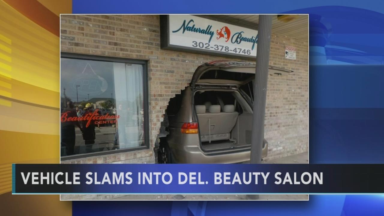 Salon owner praised after SUV hits building