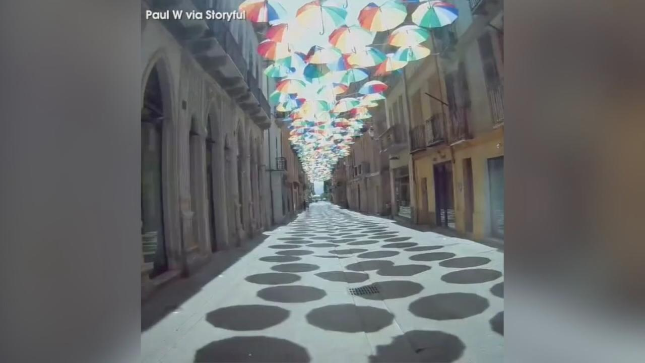 VIDEO: Vibrant umbrella display over streets of Sardinia