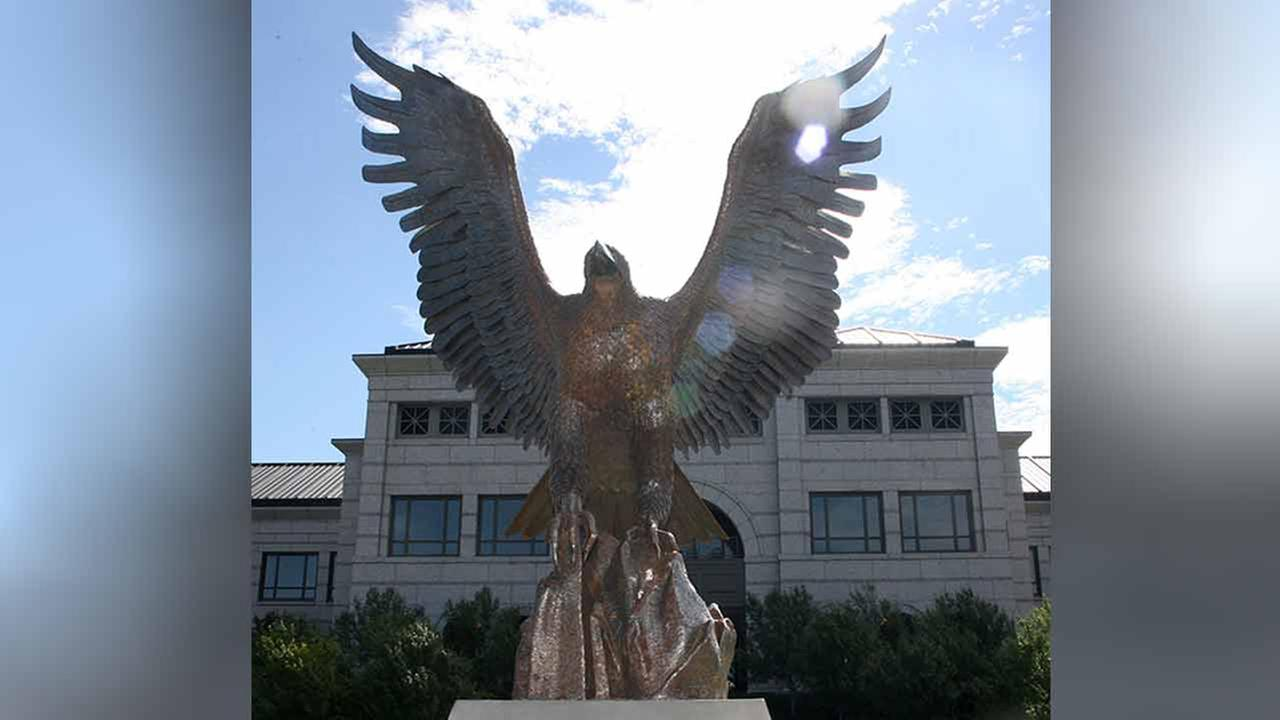 ** FILE ** The sculpture of a bird stands in front of the headquarters of Liberty Media in a file photo from Aug. 7, 2006, in the south Denver suburb of Lone Tree, Colo.