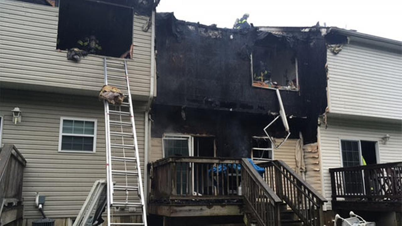 Firefighters battle blaze at town houses in Bear, Delaware