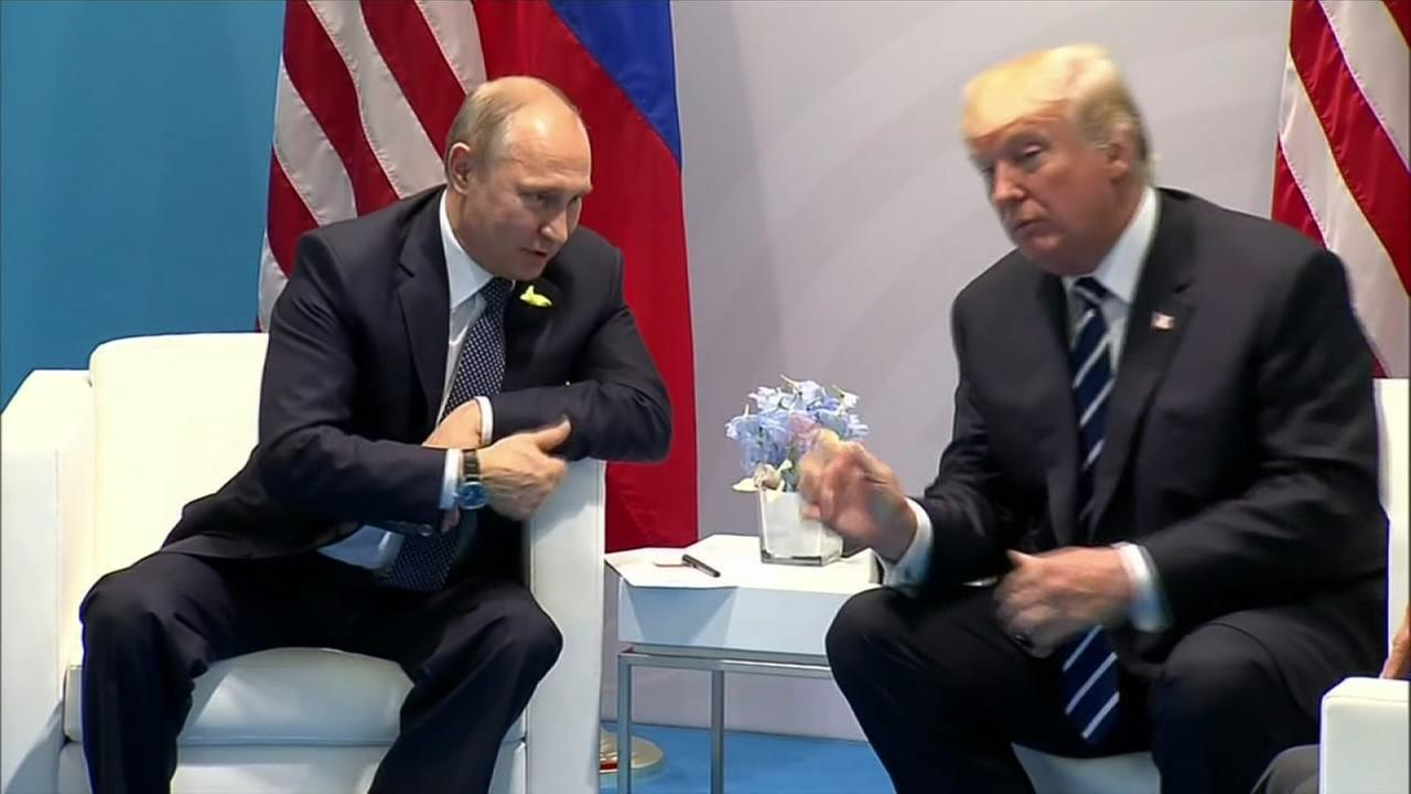 Trump confronts Putin on election hacking in meeting