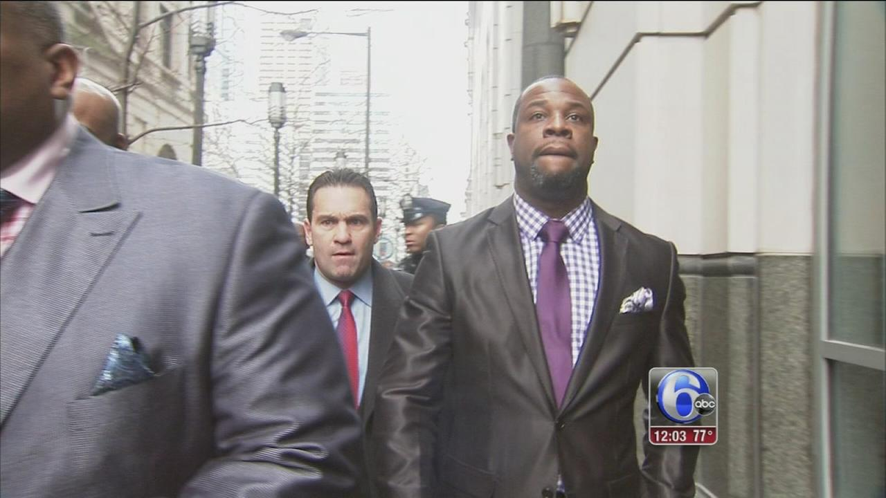 Philly cop, once accused, credited for fire rescue