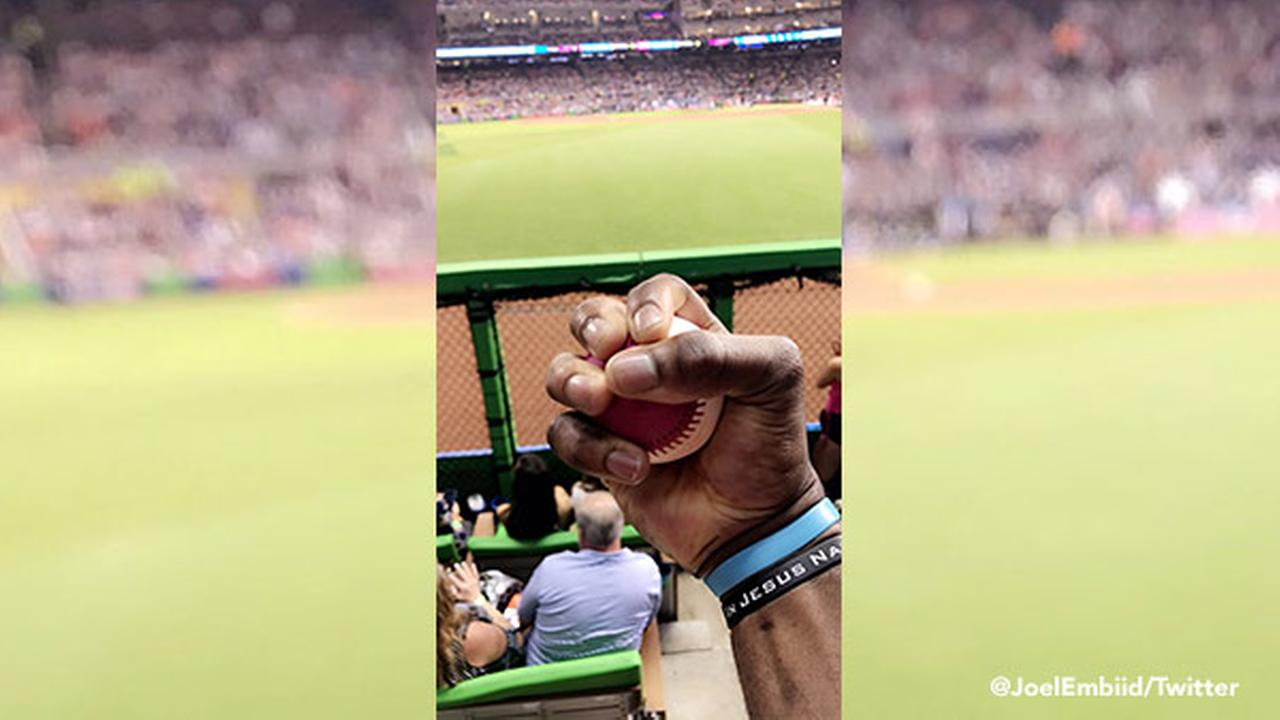 Joel Embiid catches baseballs at Home Run Derby