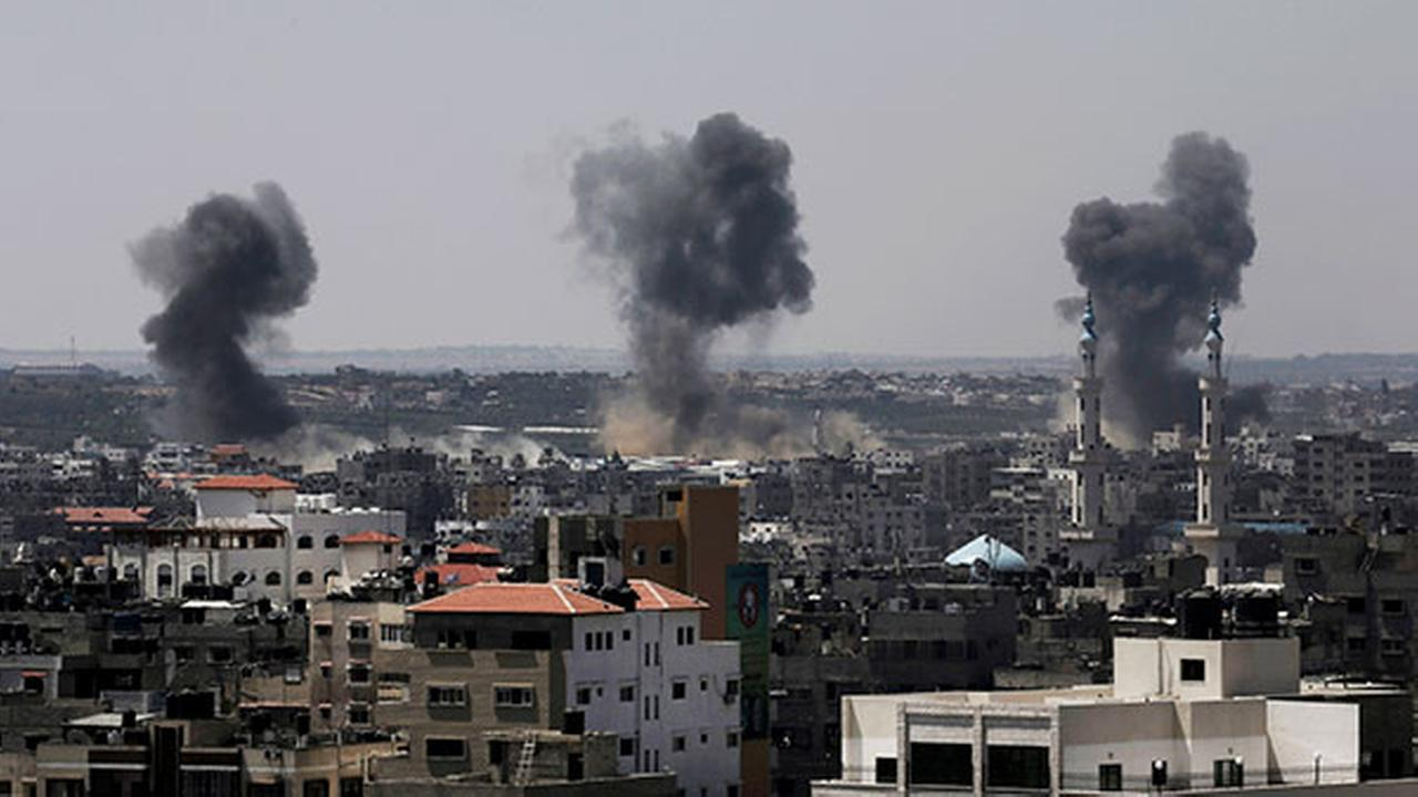 Smoke rises after Israeli missile strikes hit the northern Gaza Strip, Wednesday, July 16, 2014.