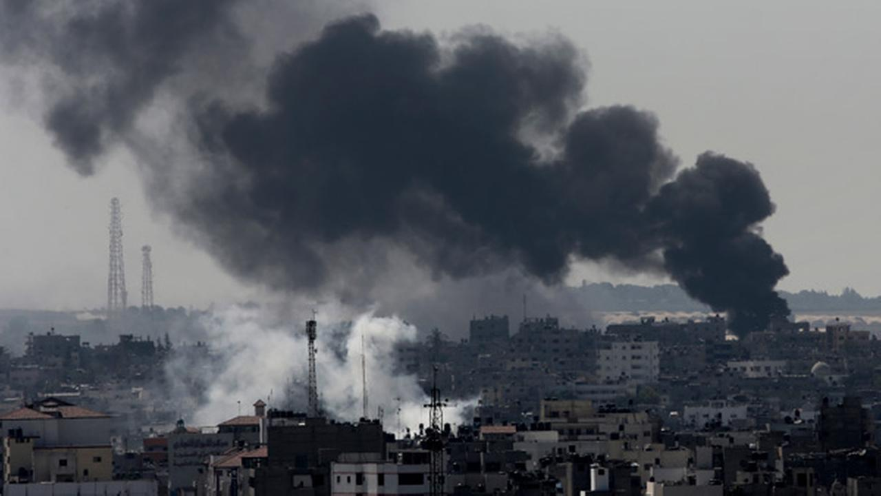 Smoke from Israeli strikes rises over Gaza City, in the northern Gaza Strip, Sunday, July 27, 2014.