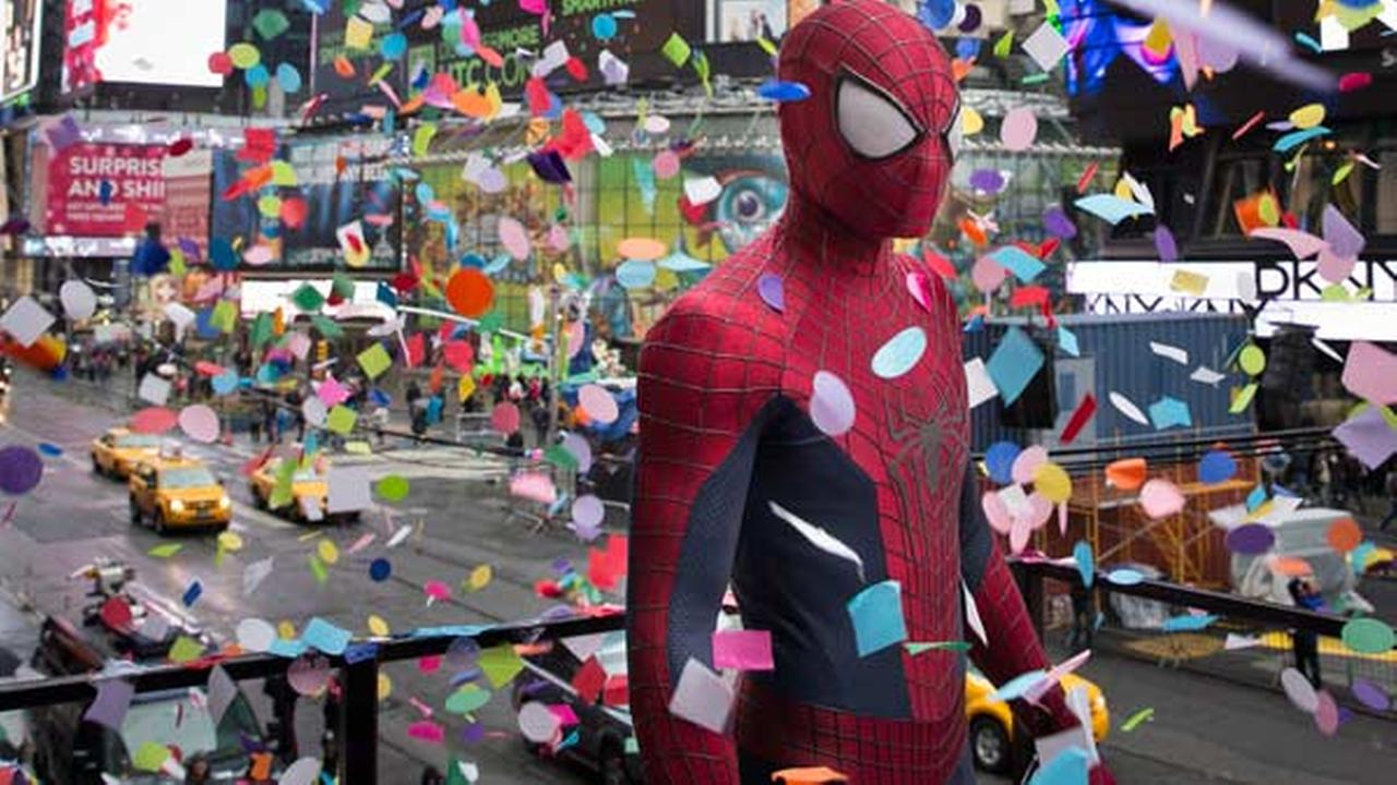 FILE - An actor portraying the comic book character Spider-Man stands during the annual confetti test in Times Square, Sunday, Dec. 29, 2013, in New York.