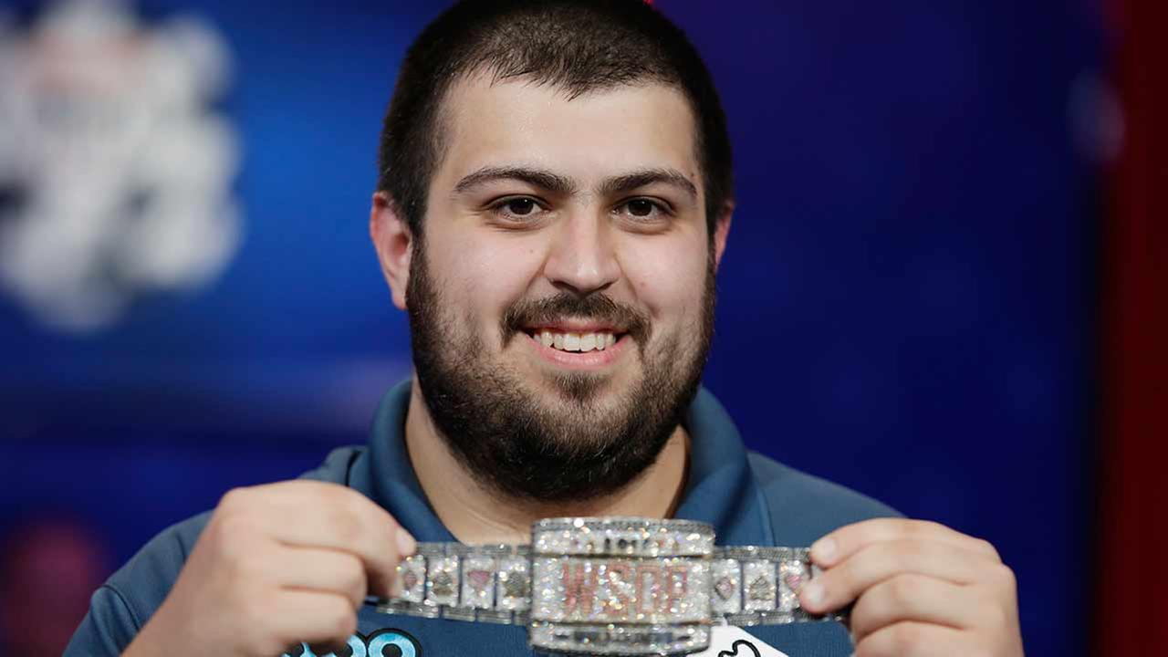Scott Blumstein holds up the bracelet after winning the World Series of Poker main event, Sunday, July 23, 2017, in Las Vegas.