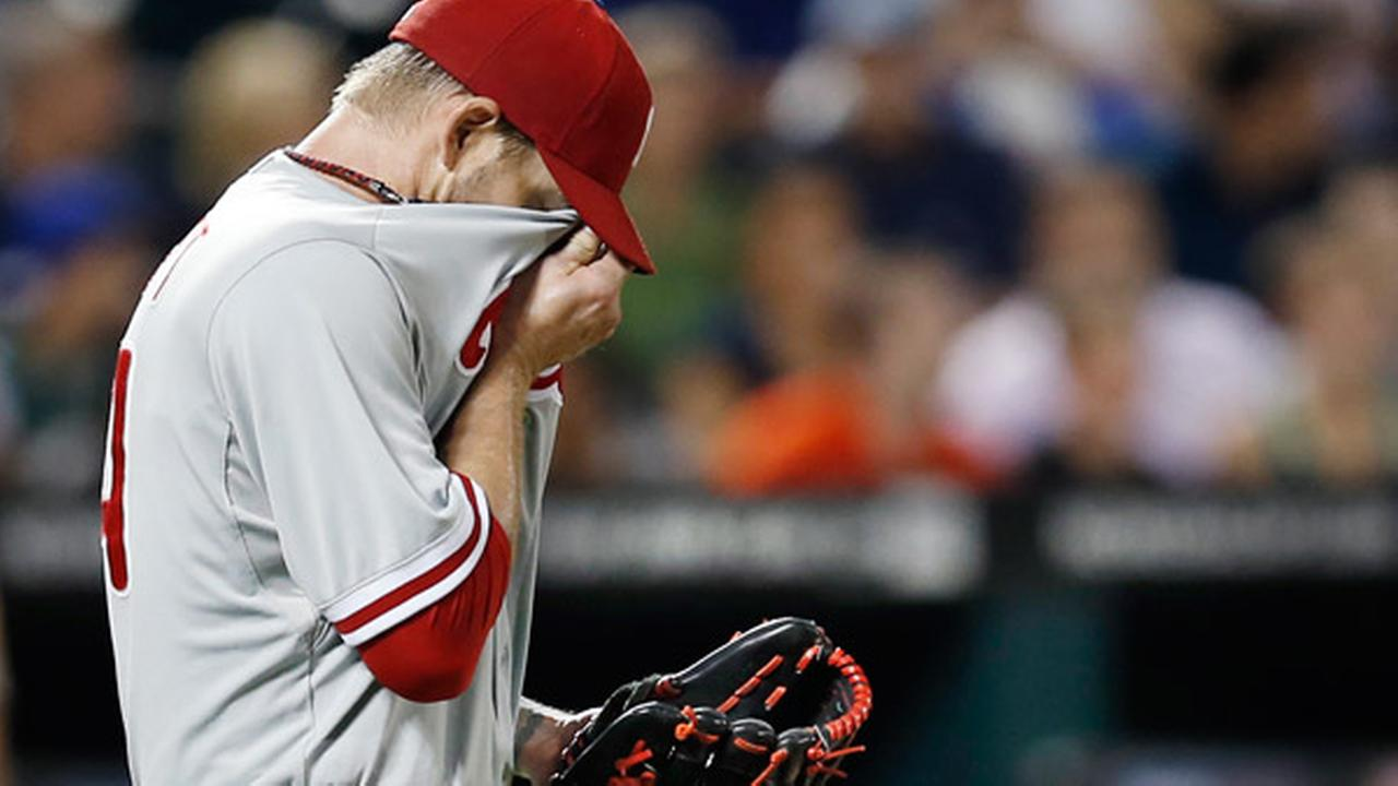 Philadelphia Phillies starting pitcher A. J. Burnett reacts, burying his face in his jersey after allowing a fifth-inning, three-run, home run to New York Mets Travis dArnaud.