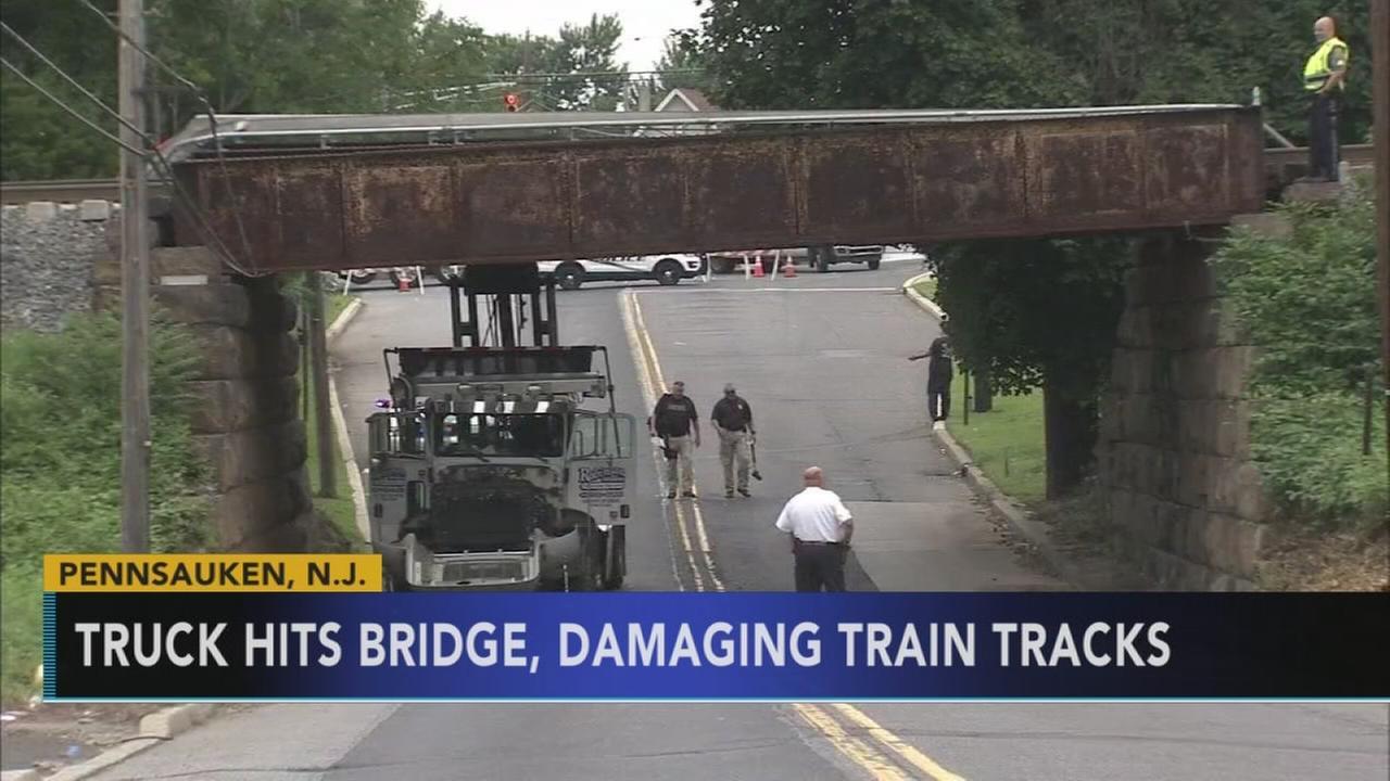 Boom truck damages bridge on NJ Transit AC rail line