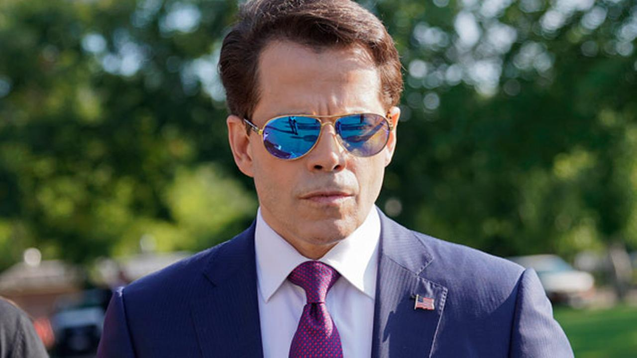 In this July 25, 2017, photo, White House communications director Anthony Scaramucci walks back to the West Wing of the White House in Washington.
