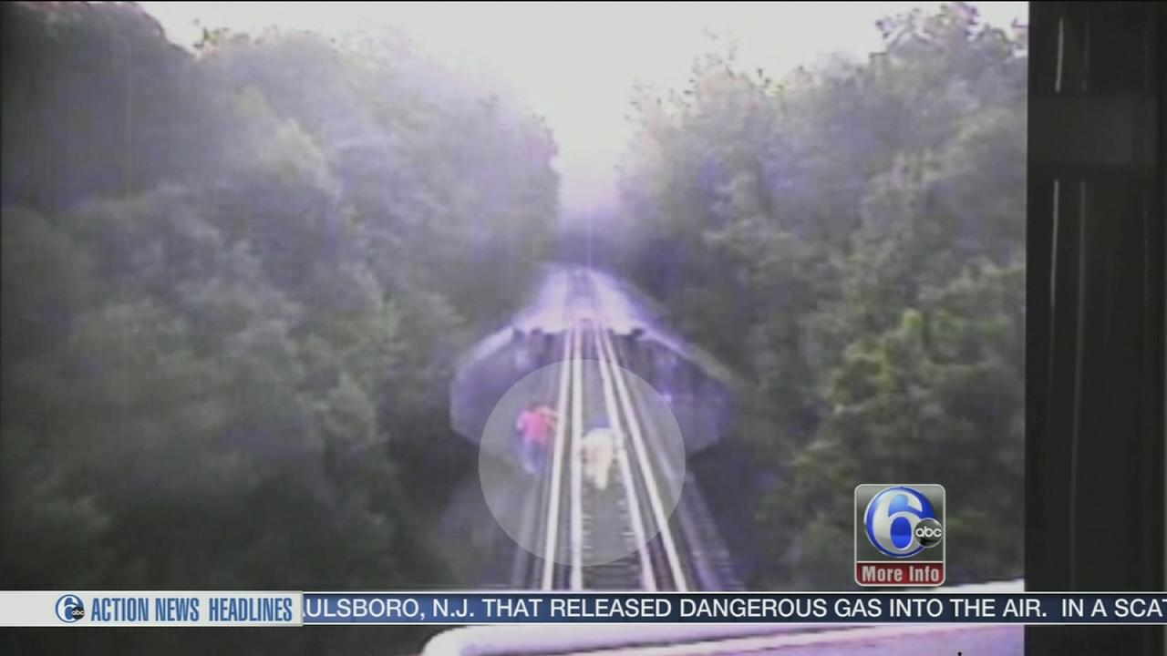 VIDEO: Women trapped on bridge as train nears