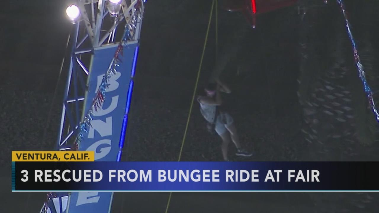 3 rescued from bungee ride at fair
