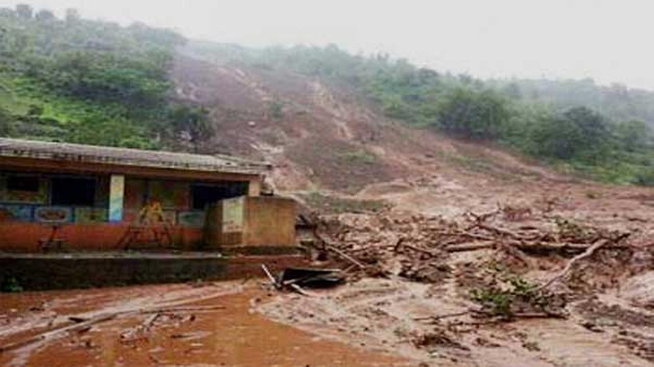 Mud and slush surround a building after a mudslide in Malin village, in the western Indian state of Maharashtra, Wednesday, July 30, 2014.