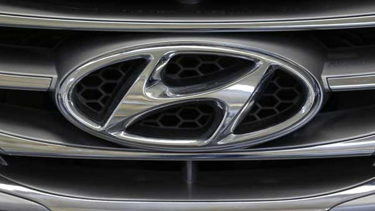 This Photo taken Feb. 14, 2013 shows the Hyundai logo on the grill of a Hyundai automobile at the 2013 Pittsburgh Auto Show in Pittsburgh. (AP Photo/Gene J. Puskar)