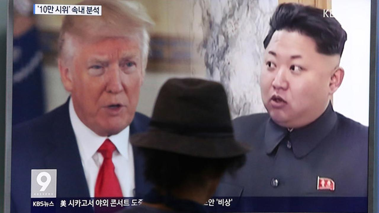 A man watches a television screen showing U.S. President Donald Trump, left, and North Korean leader Kim Jong Un during a news program at the Seoul Train Station in Seoul.