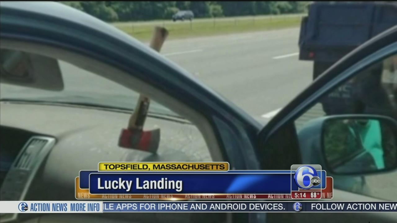 VIDEO: Ax flys through windshield of moving vehicle