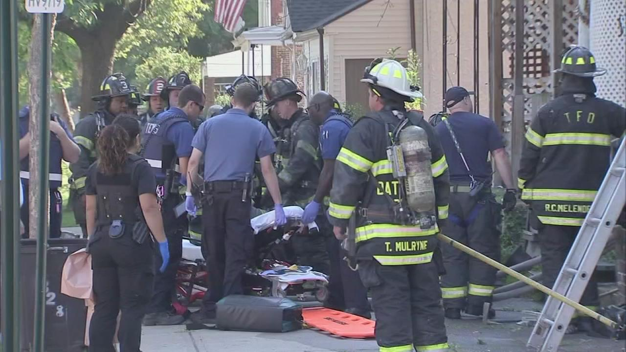 VIDEO: 2 passersby pull woman from Trenton house fire