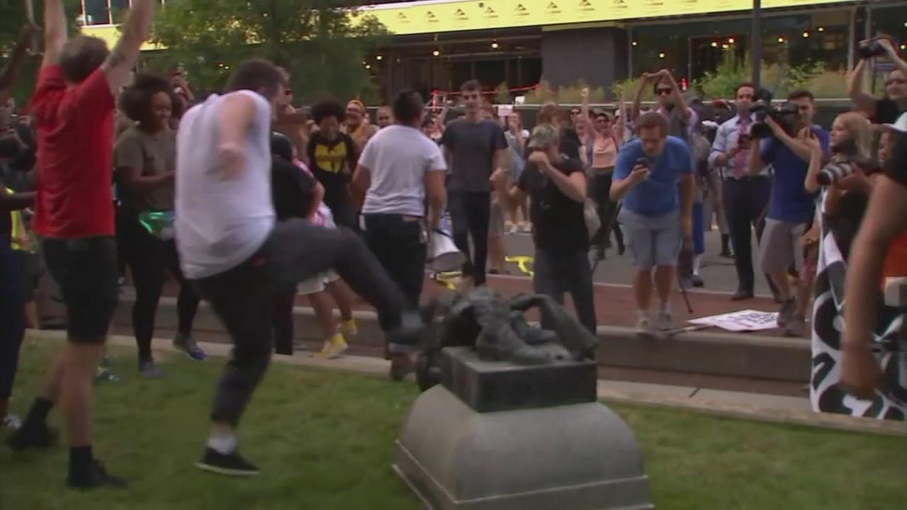 Protestors knock over NC statue