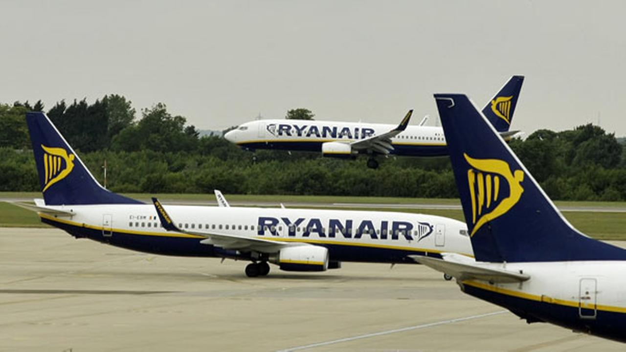 FILE- In this Tuesday July 21, 2009 file photo, Ryanair planes are seen at Stansted Airport in England.