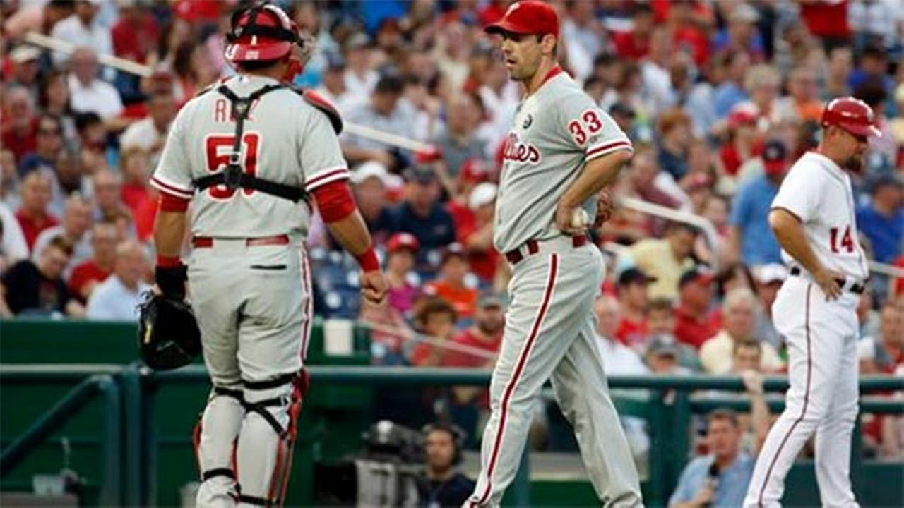 Philadelphia Phillies catcher Carlos Ruiz (51) walks to talk with starting pitcher Cliff Lee (33) during the third inning of a baseball game at Nationals Park July 31, 2014.