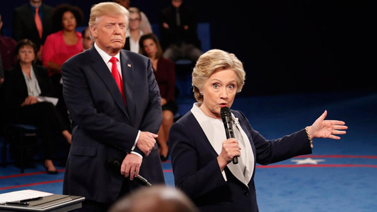 Democratic presidential nominee Hillary Clinton speaks as Republican presidential nominee Donald Trump listens during the second presidential debate at Washington University.