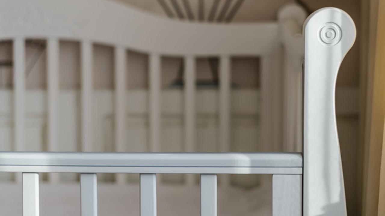 Toddler suffocated by weighted mattress on crib, parents charged