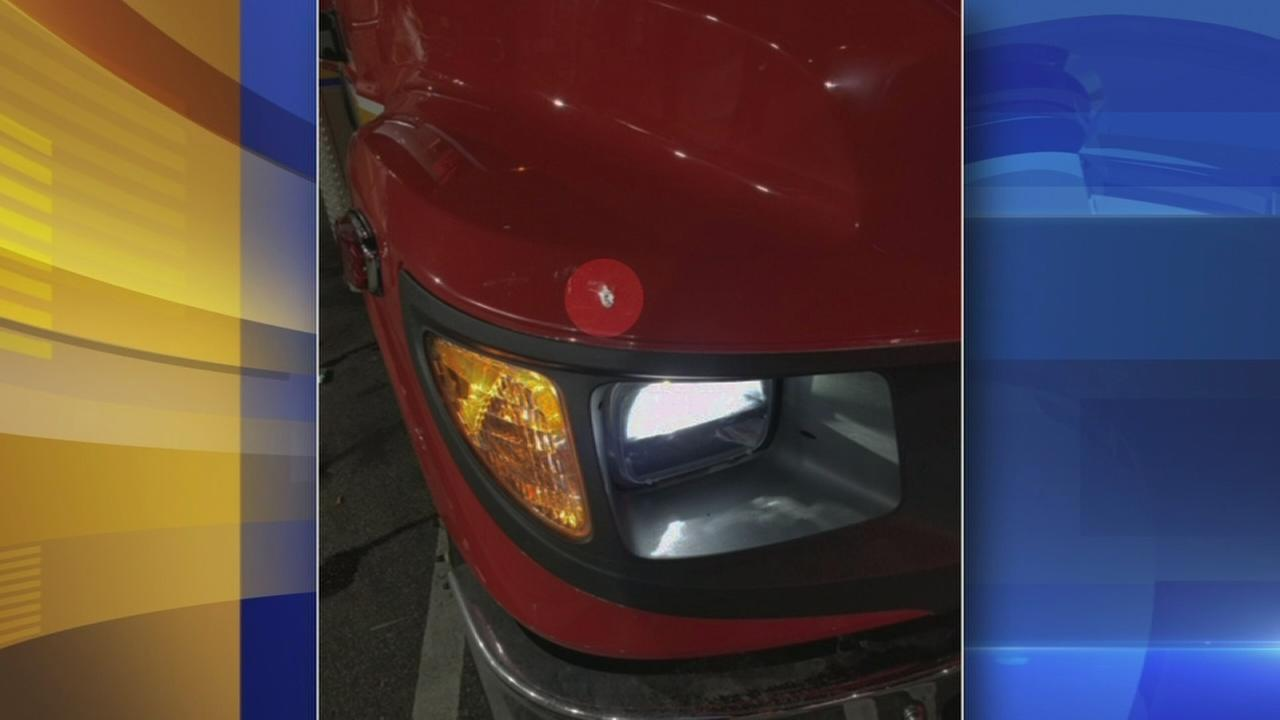 Ambulance struck by bullet carrying injured patient