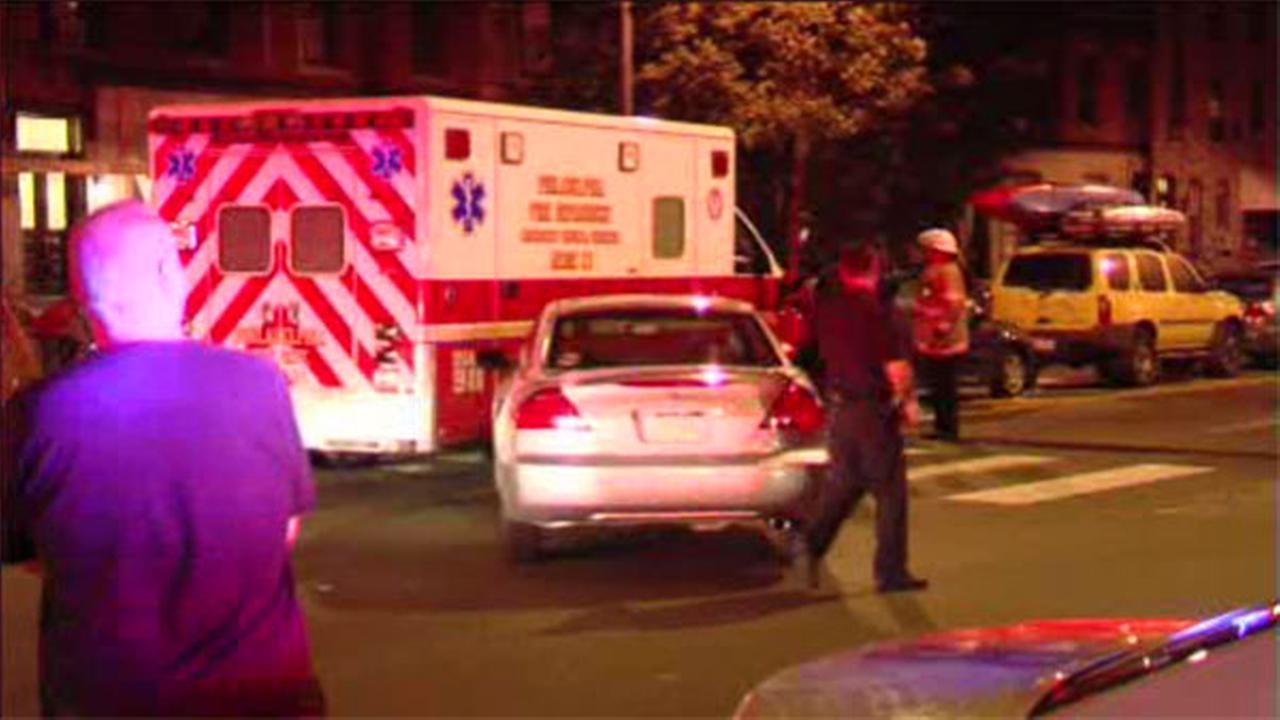 Ambulance responding to shooting crashes into car