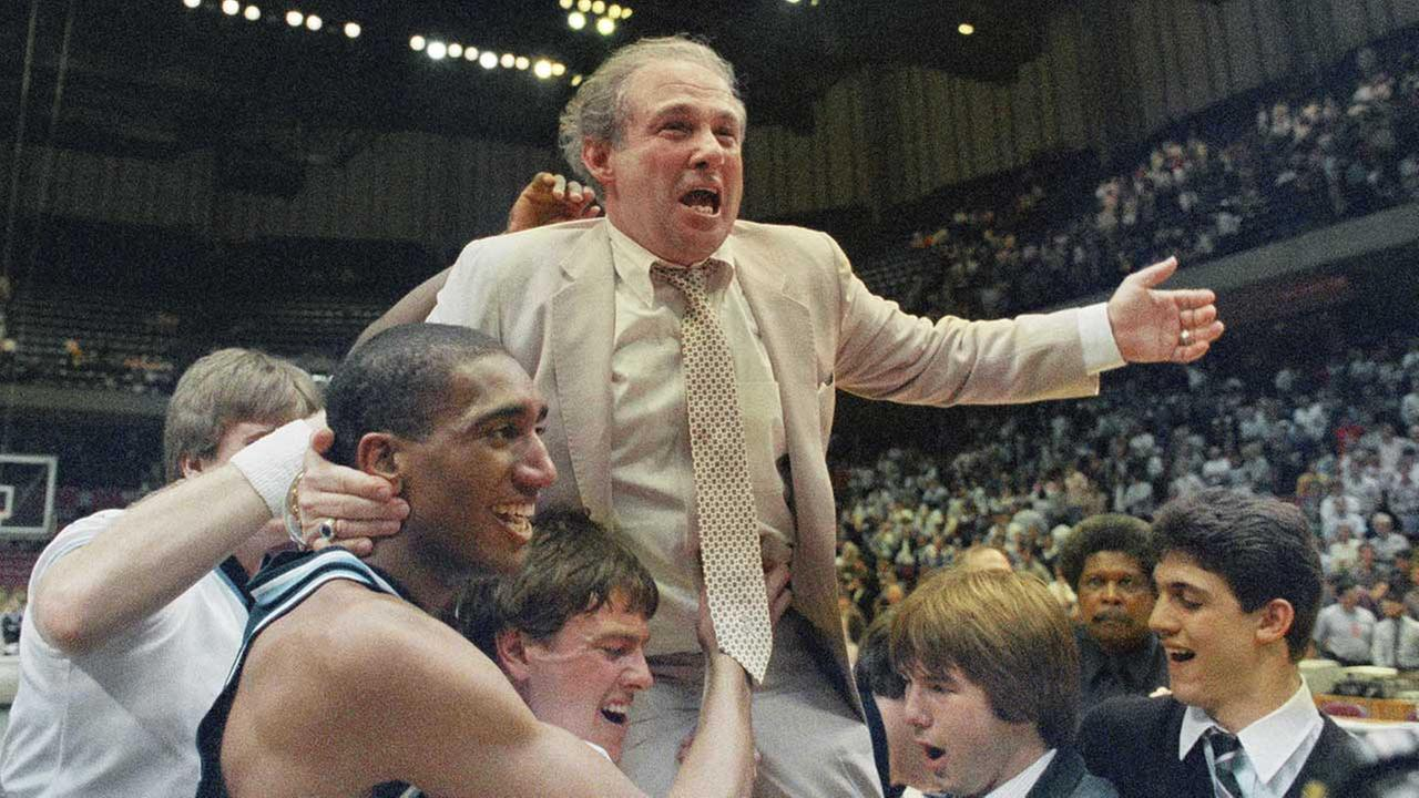 Villanova coach Rollie Massimino takes a victory ride on his players shoulders March 24, 1985. (AP Photo)